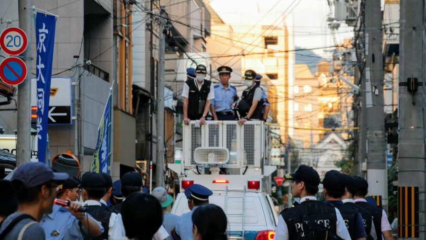 Japanese police escorting protesters
